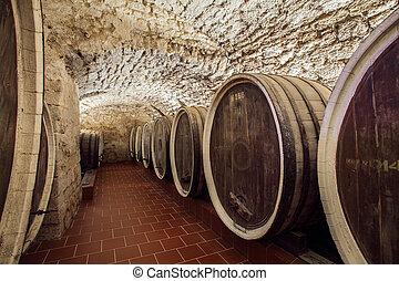 old winery - huge wine barrels in an old cellar