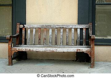 Old wodden bench on a sidwalk