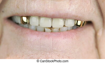 Old woman aged 80s smiling with false teeth - The old woman...