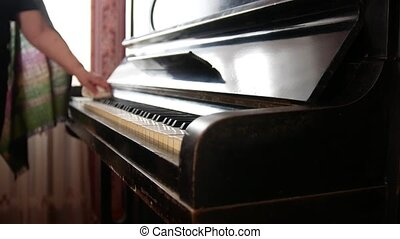 Old woman at home wipes the dust on piano - close up - Old...