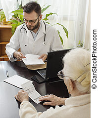 Old woman at the doctor geriatrician.geriatrician doctor with a patient in his office.