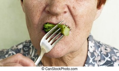 old woman eating choices eating vegetables