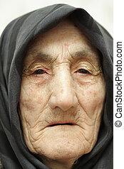 Very old woman face closeup portrait