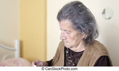 """""""old woman gets a cold, blowing nose"""""""
