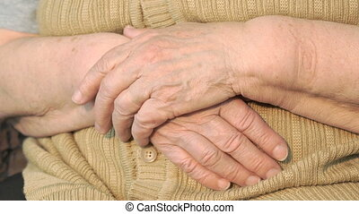 Old woman hand with loose skin. Close up
