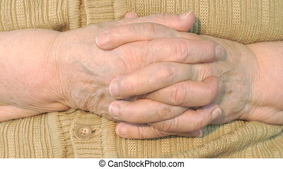 Old woman hand with wrinkled skin