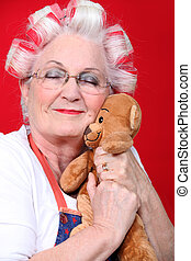 Old woman holding a teddy bear