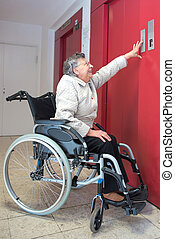 old woman in a wheelchair using lift