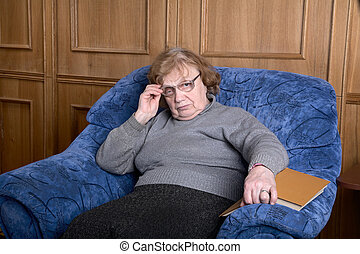 old woman in an armchair