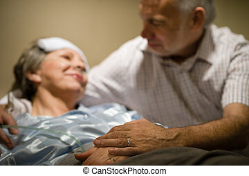 Old woman in pain lying bed