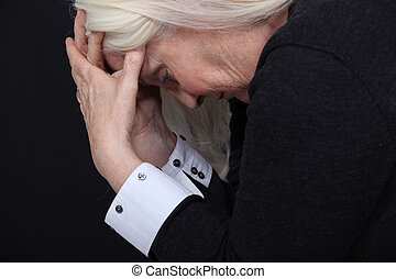 Old woman in pain