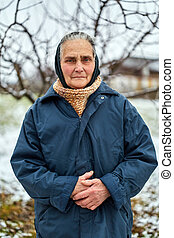 Old woman in the countryside