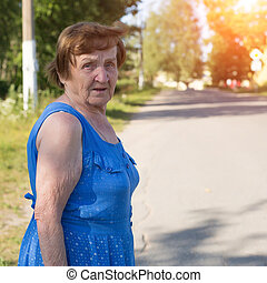 Old woman in the street.