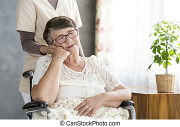 Old woman in the wheelchair