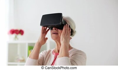 old woman in virtual reality headset or 3d glasses -...