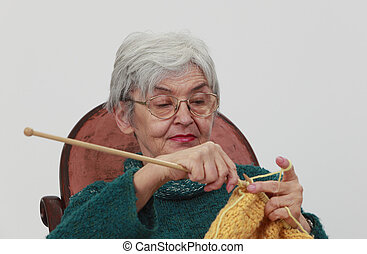 Old woman knitting - Portrait of an old woman...