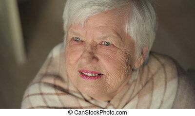 Old Woman Looking Forward at the Sky - Senior woman...