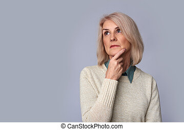 old woman looking up to copy space