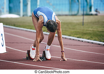 old woman on the starting blocks