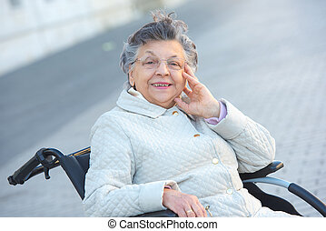 old woman on the wheelchair posing