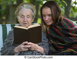 Old woman reads a book