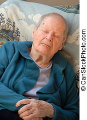 Old woman sleeping i