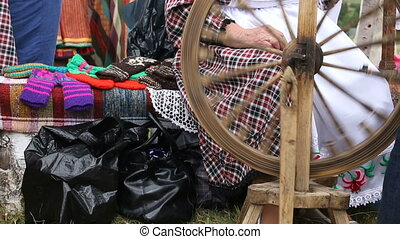 Old Woman Spinning Wool. Shallow depth of field