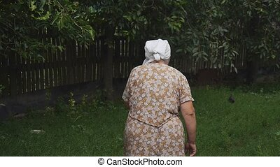 Old woman talking on the phone with her grandson