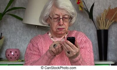 Old woman using cell phone
