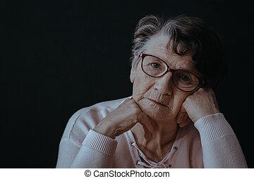 Old woman wearing eyeglasses