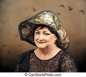 Portrait of middle aged brunette woman wearing tapestry hat