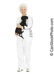 old woman with a dachshund in her arms
