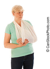 Old woman with broken wrist in gypsum - Old woman with...