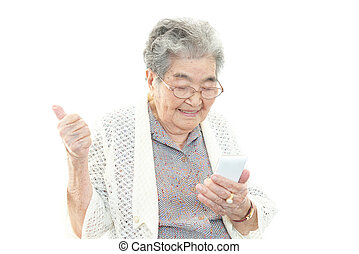 Old woman with smart phone - Portrait of old woman on a...