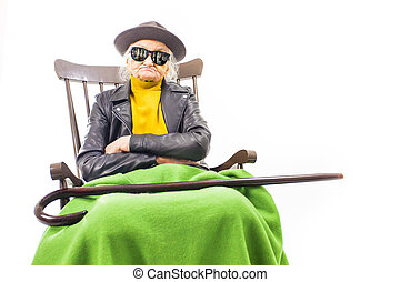 Old woman with sunglasses and hat.