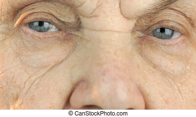 Old woman's face with disturbing look of face. Close up