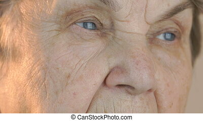Old woman's face with tired expression of face. Close up