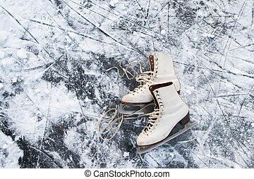 Old womans ice skates on the ice.