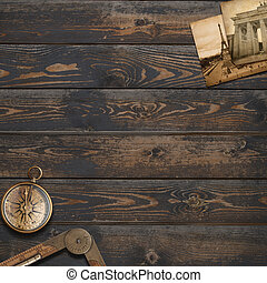 Old wood background with compass. Adventure and travel concept.