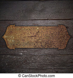 Old wood background with rusty metal plate. Design template