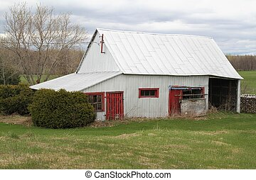 Old wood  barn with red door