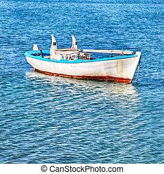 old wood boat at a Mediterranean sea(Greece)