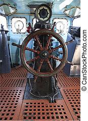 old wood boat steering wheel in military war ship