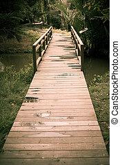 Old wood bridge pathway