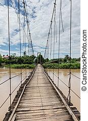Old wood bridge with river landscape