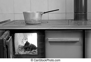 old wood-burning stove in the kitchen of ancient home