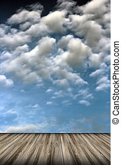 old wood floor and cloudy sky