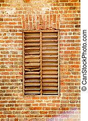 Old Wood Slat Window in Brick Wall