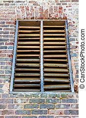 Old Wood Slat Window on Brick Wall