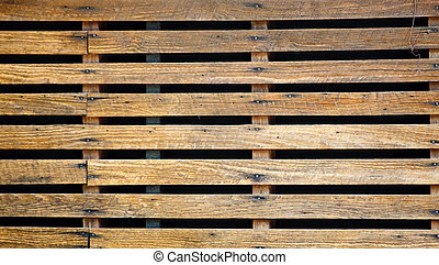 Old Wood Slats Over Black - Old wood slats nailed over a...
